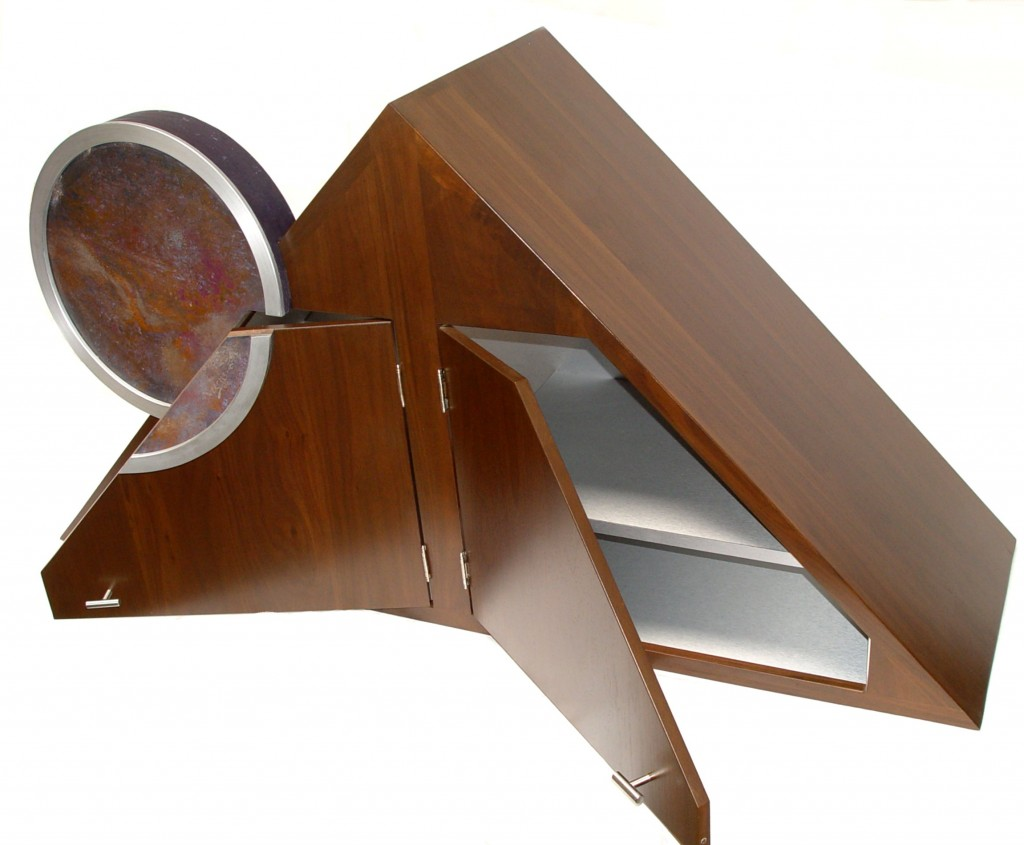 Walnut and stainless steel kitchen cabinet with a circular abstract art painting.